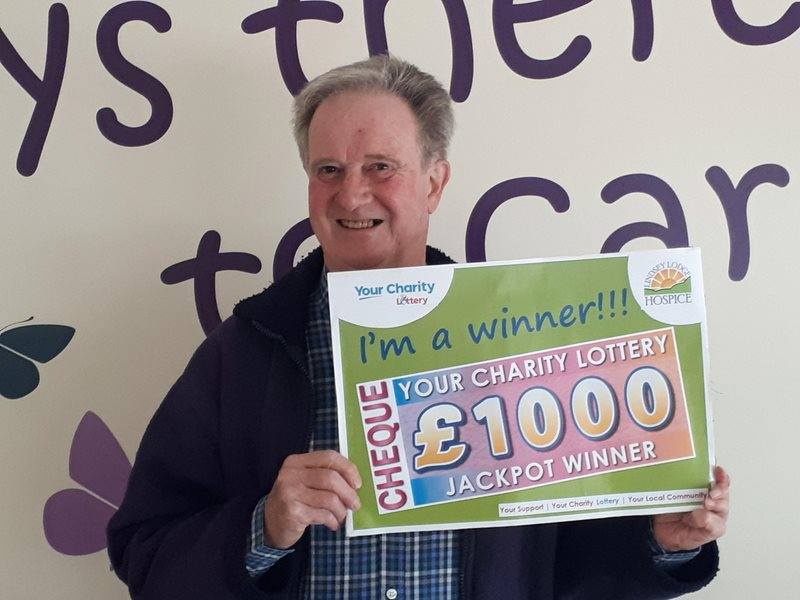 Photo of paul ashley with cheque
