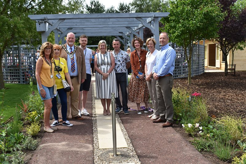 A group of people pictured in the garden