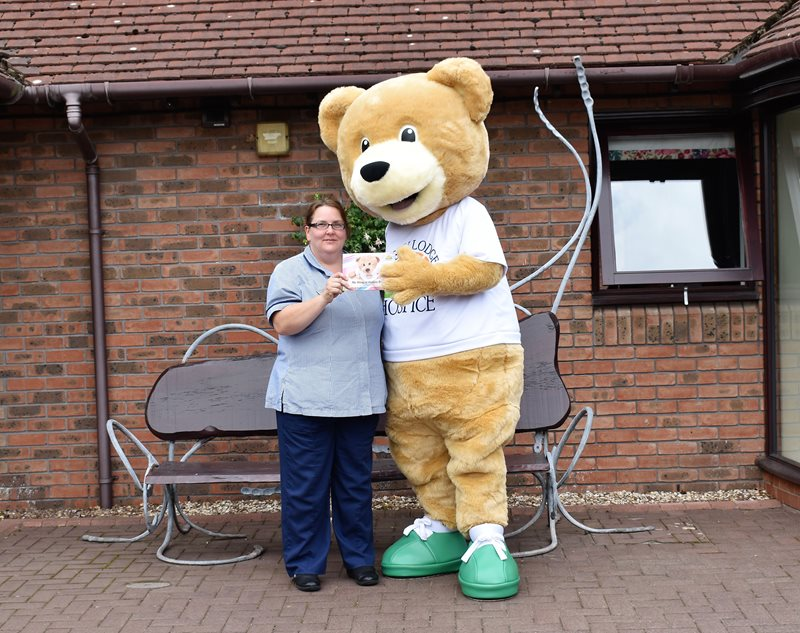 Lindsey Lodge Hospice Staff Nurse Elaine Bradley, who features in the Hospice's new children's book, is pictured with Lindsey Bear at the Hospice.